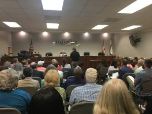 A standing room only crowd attended a public hearing on a proposed 1 percent occupational tax.