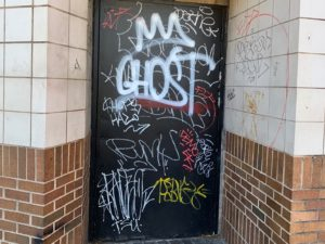 Graffiti on front door 20th Street-- heart of Five Points South